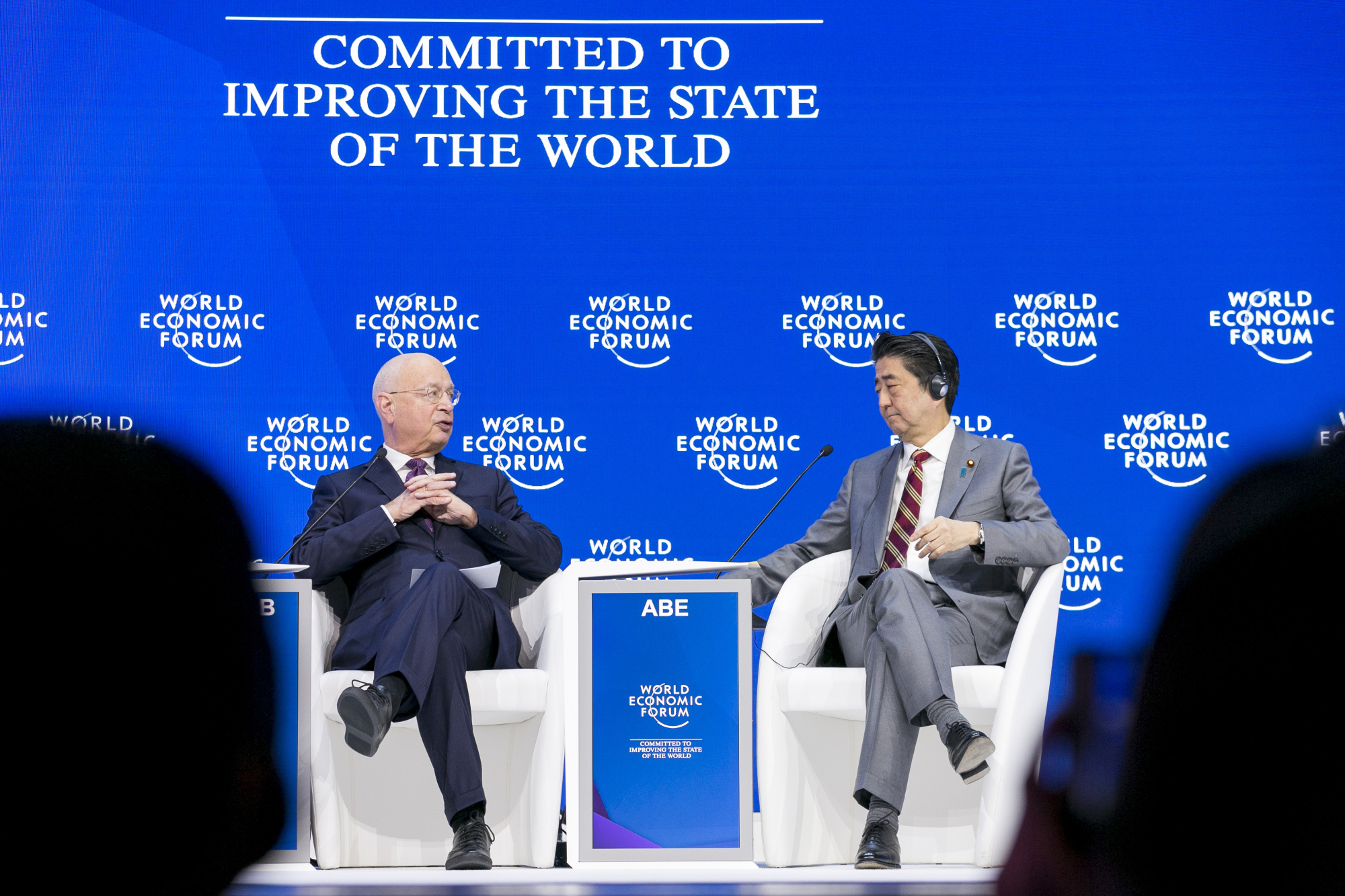 Klaus Schwab, founder and executive chairman of the World Economic Forum (WEF), speaks with Prime Minister Shinzo Abe during a session at the 2019 WEF Annual Meeting on Jan. 23, 2019.  WORLD ECONOMIC FORUM