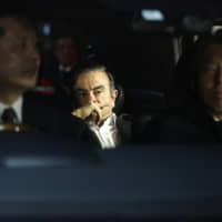 On the move: Carlos Ghosn leaves his lawyer's office in March 2019. The former Nissan boss skipped bail and fled Japan at the end of December and eventually landed in Lebanon. | BLOOMBERG