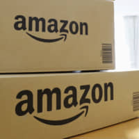 Pay up: Amazon packages sit on a table in Yokohama.