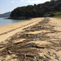Drifting onto the shore: Plastic garbage washes ashore with more natural debris prompting the residents of Shiraishi Island to take part in regular beach cleanups. | AMY CHAVEZ