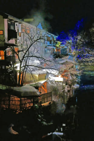 Illuminated plumes of steam from Yunishigawa's natural hot springs add to the town's romance. | STEPHEN MANSFIELD