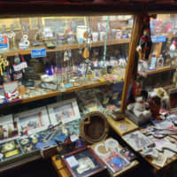 Keepsakes: Display cases at Good Time Charlie, in which Nagatani keeps trinkets from his career. | TIMOTHY NEROZZI