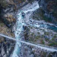 River crossing: A suspension bridge runs over the milky blue waters of the Dudh Kosi River, on the lower part of the trek. | OSCAR BOYD