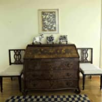 Cows, chests and checkered carpets: English ornamental cows and a Tibetan carpet with blue-and-white coloring go well with a framed katagami paper stencil. The chest was made in southern Switzerland in the 18th century.   HIROSHI ABE