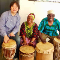 Musical travel: Motoki Hirai takes part in a drumming jam session with local musicians during a trip to Zanzibar, Tanzania. | COURTESY OF MOTOKI HIRAI