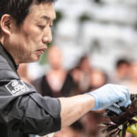 A delicate touch: Akihiro Kakimoto adds the final details to a chocolate flower. | IVO ROVIRA & ANA PONCE