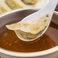 Flavor bomb: Ebisu no Yasubei's sui-gyōza (steamed dumplings) come with extra soup or tare sauce for dipping. | COURTESY OF MFC GROUP