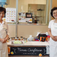 Citrus sisters: Seiko (left) and Yoriko Ninomiya sell jars of handmade marmalade, which they make from seasonal Ehime Prefecture citrus about five times a month. | KYODO