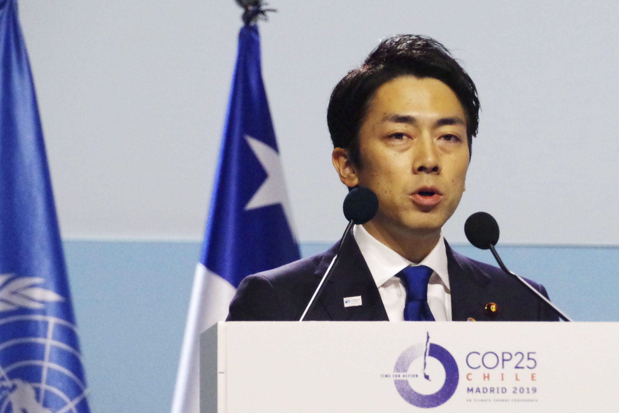Environment Minister Shinjiro Koizumi makes a speech at a U.N. climate conference in Madrid in December.   KYODO