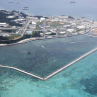 Sea change: Ongoing land reclamation work in the Henoko coastal district of Nago, Okinawa Prefecture, the relocation site for U.S. Marine Corps Air Station Futenma. | KYODO