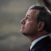 U.S. Supreme Court Chief Justice John Roberts  will find it a challenge to avoid an appearance of partisanship when he presides over President Donald Trump's impeachment trial. | BLOOMBERG