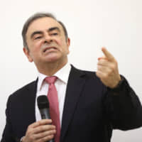 Carlos Ghosn, former chief executive officer of Nissan Motor Co., speaks to the media at the Lebanese Press Syndicate in Beirut on Wednesday | BLOOMBERG