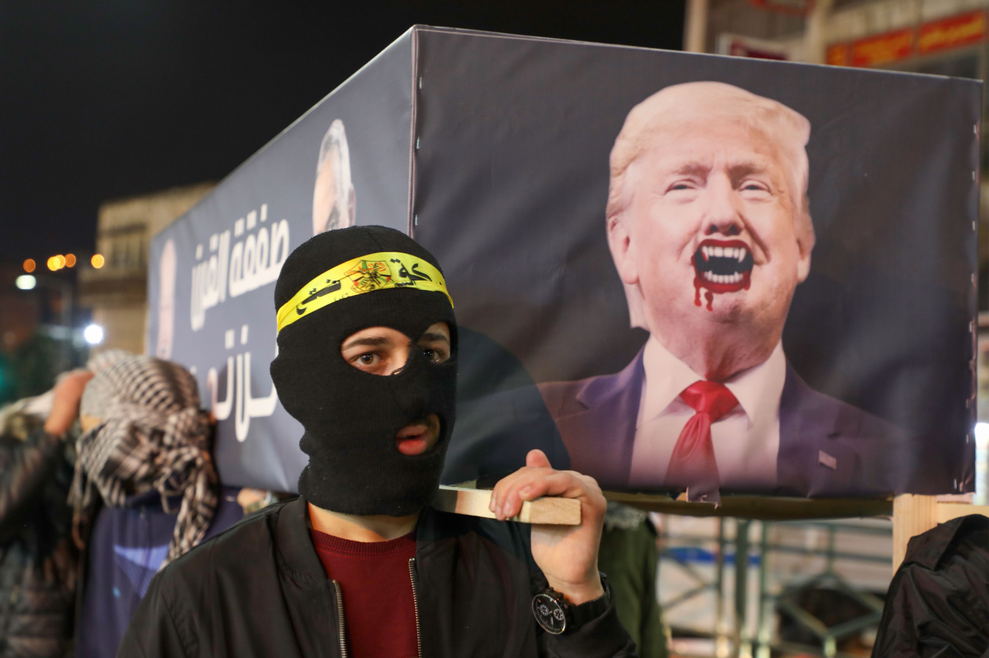 Palestinians protest U.S. President Donald Trump's Middle East peace proposal in the West Bank city of Nablus on Tuesday, hours before it was revealed. | AFP-JIJI