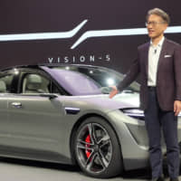 Sony President and CEO Kenichiro Yoshida unveils the Vision-S prototype electric vehicle at a Jan. 6 press conference for the CES show in Las Vegas. | WAICHI SEKIGUCHI