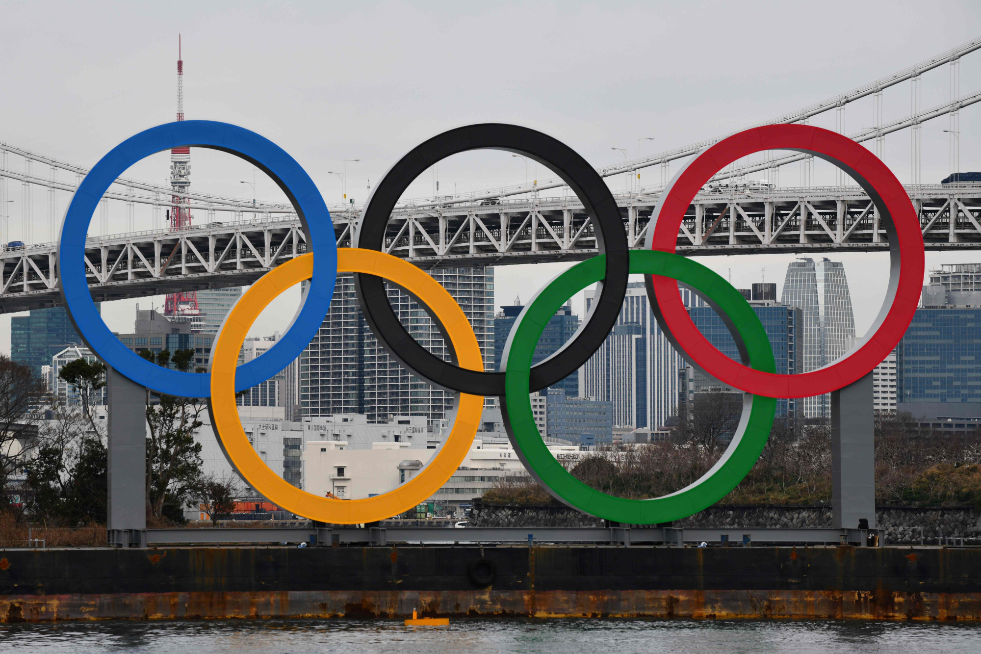 A barge hauls the Olympic logo on Saturday to install in Tokyo's Odaiba district. The global spotlight will shine on Japan this summer when it hosts the Olympics and Paralympics. | AFP-JIJI