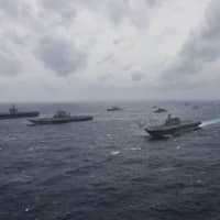 Japanese, Indian and U.S. naval vessels sail in formation during Exercise Malabar 2017. | U.S. NAVY