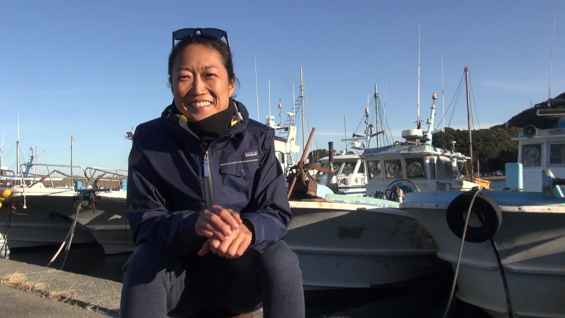 Aiko Ono, an ama (female diver) in Ijika district of Toba, Mie Prefecture, talks about her work at Ijika port. | KYODO