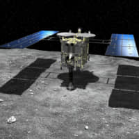 An image provided by the Japan Aerospace Exploration Agency last April shows a computer-generated rendering of Hayabusa2 on the surface of the asteroid Ryugu. | JAXA / VIA KYODO