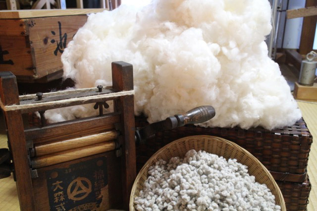 Old-school techniques: A display of raw cotton, a cotton gin and a basket of the seeds removed from bolls. | COURTESY OF JIN SHIRAI