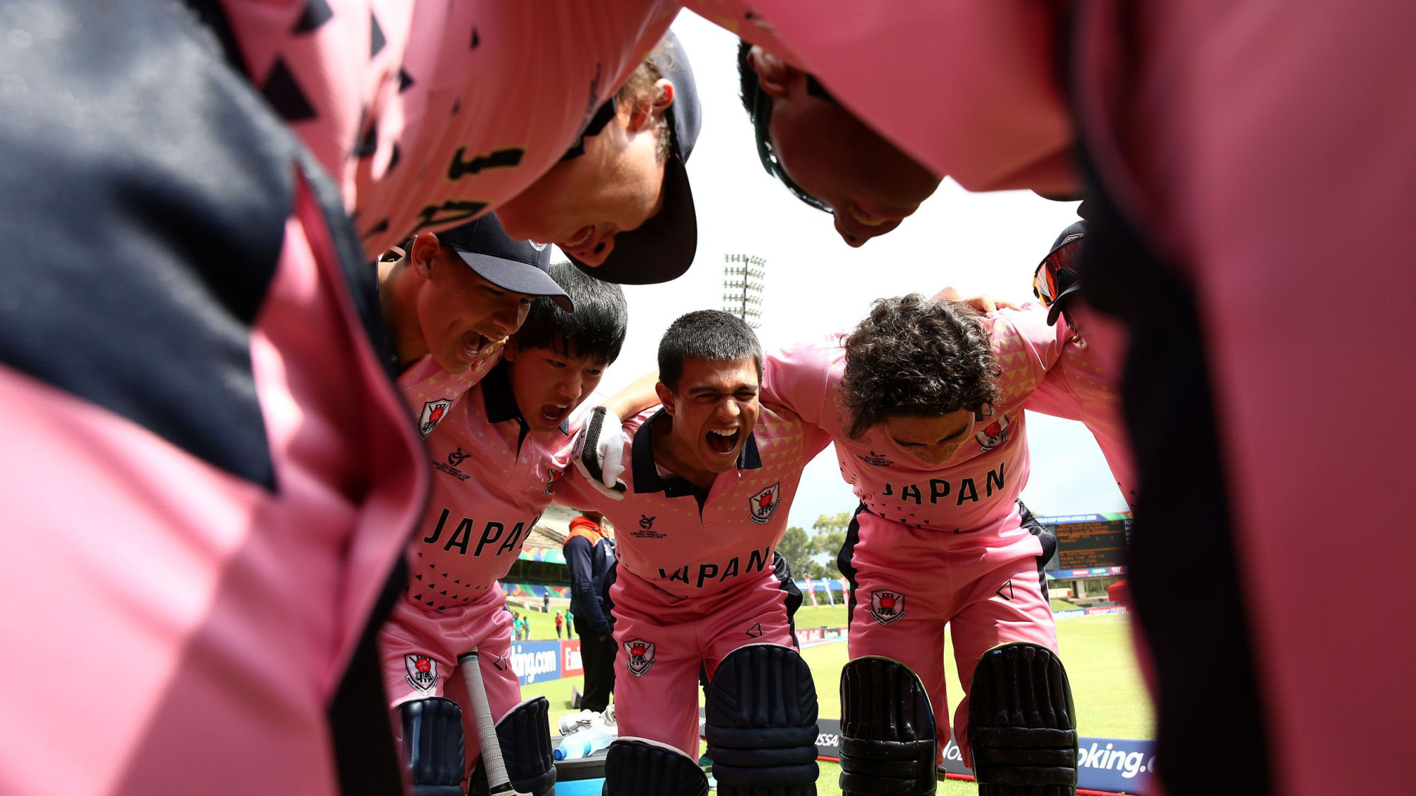 Japan players form  a huddle before their match against India in Potchefstroom, South Africa, on Jan. 21. | INTERNATIONAL CRICKET COUNCIL / VIA GETTY IMAGES