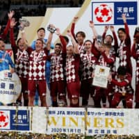 Vissel Kobe's players celebrate after winning the club's first-ever Emperor's Cup title on Wednesday at the newly built National Stadium in Tokyo. Vissel defeated Antlers 2-0 in the final. | REUTERS