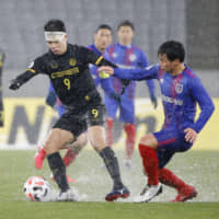FC Tokyo striker Shuto Abe (right) contends for the ball against Ceres-Negros' Takashi Odawara on Tuesday at Tokyo Stadium. | KYODO