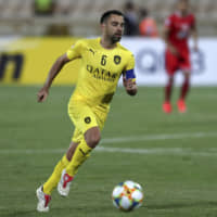 Al-Sadd's Xavi dribbles the ball during an Asian Champions League match in Tehran on May 20, 2019. The Asian Football Confederation is reportedly considering a ban on hosting international fixtures in Iran due to security concerns. | AP