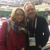 Announcer Ted Barton poses with a fan at the Russian Championships last month in Krasnoyarsk. | INSTAGRAM