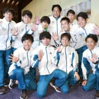 Aoyama Gakuin University runners and coach Susumu Hara (back row) pose for a photo after winning the Hakone ekiden on Friday. | KYODO