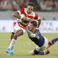 Kotaro Matsushima scores a try for Japan against Russia in their Rugby World Cup opener on Sept. 20 in Tokyo. | KYODO