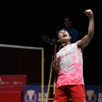 Kento Momota reacts after winning against Denmark's Viktor Axelsen during their men's singles final match at the Malaysia Masters badminton tournament in Kuala Lumpur on Sunday. | AFP-JIJI