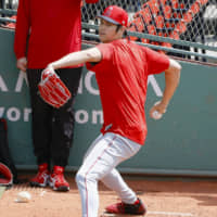 A rule change for the 2020 season will allow Shohei Ohtani to pitch in the minor league as he continues to bat for the Angels. | KYODO