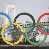 An monument depicting the Olympic rings is seen in Tokyo's Odaiba waterfront district on Friday. Similar structures are scheduled to placed in other parts of the city as well. | KYODO