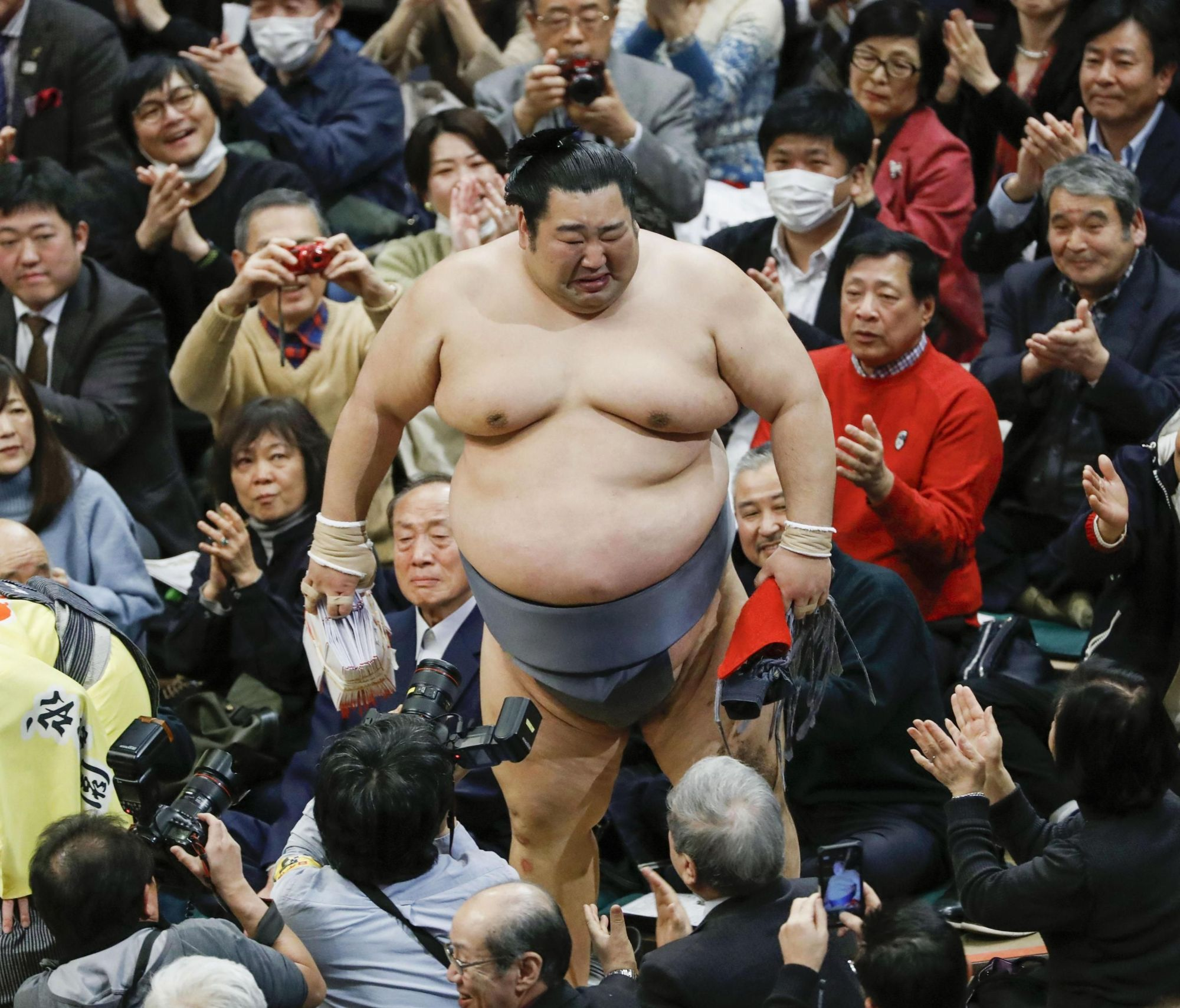Tokushoryu sheds tears in front of a jubilant crowd after winning his first basho title on Sunday in Tokyo. | KYODO