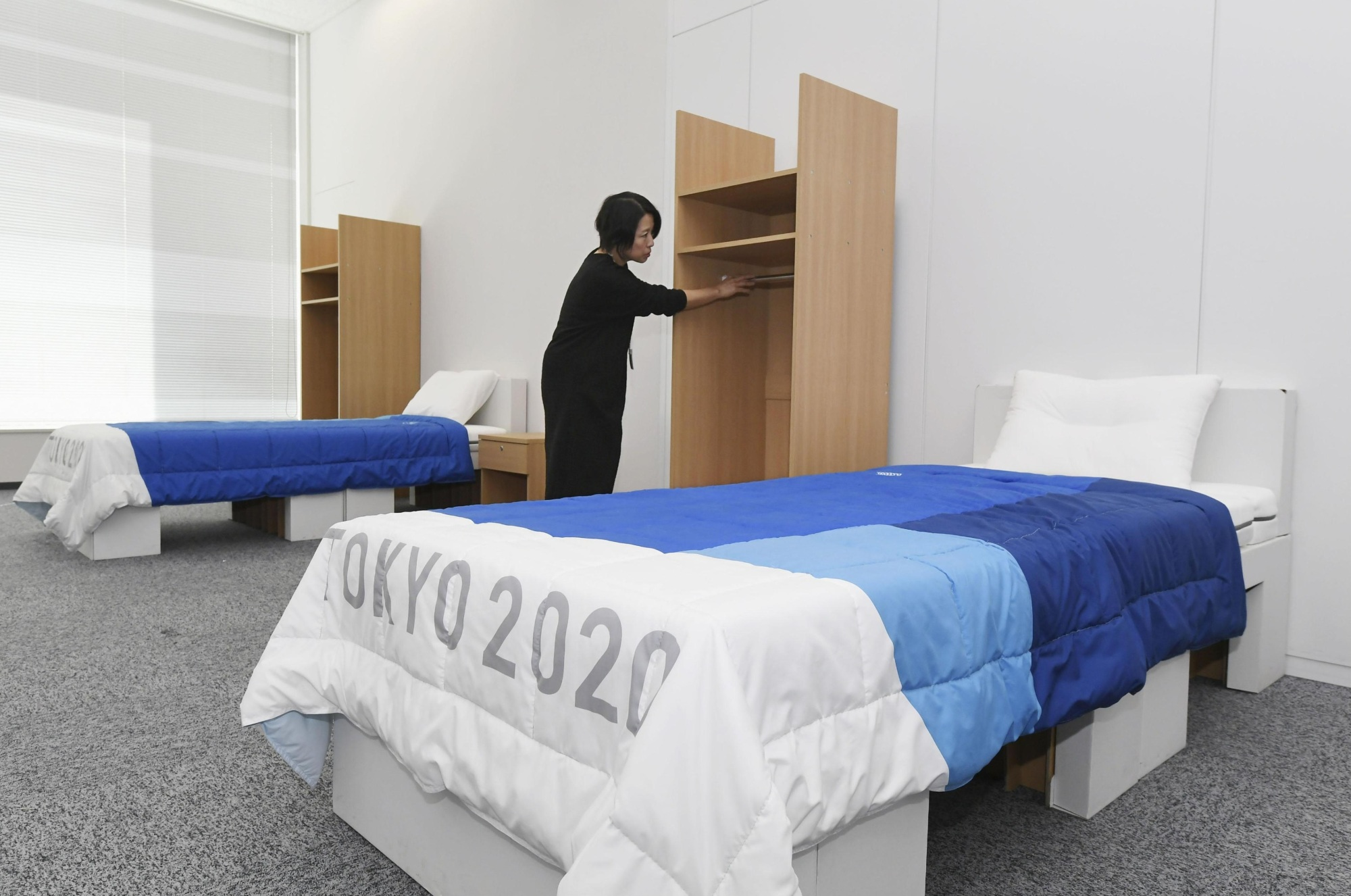 A bedroom in the athletes' village for the 2020 Tokyo Olympics is displayed to the media on Thursday. | KYODO