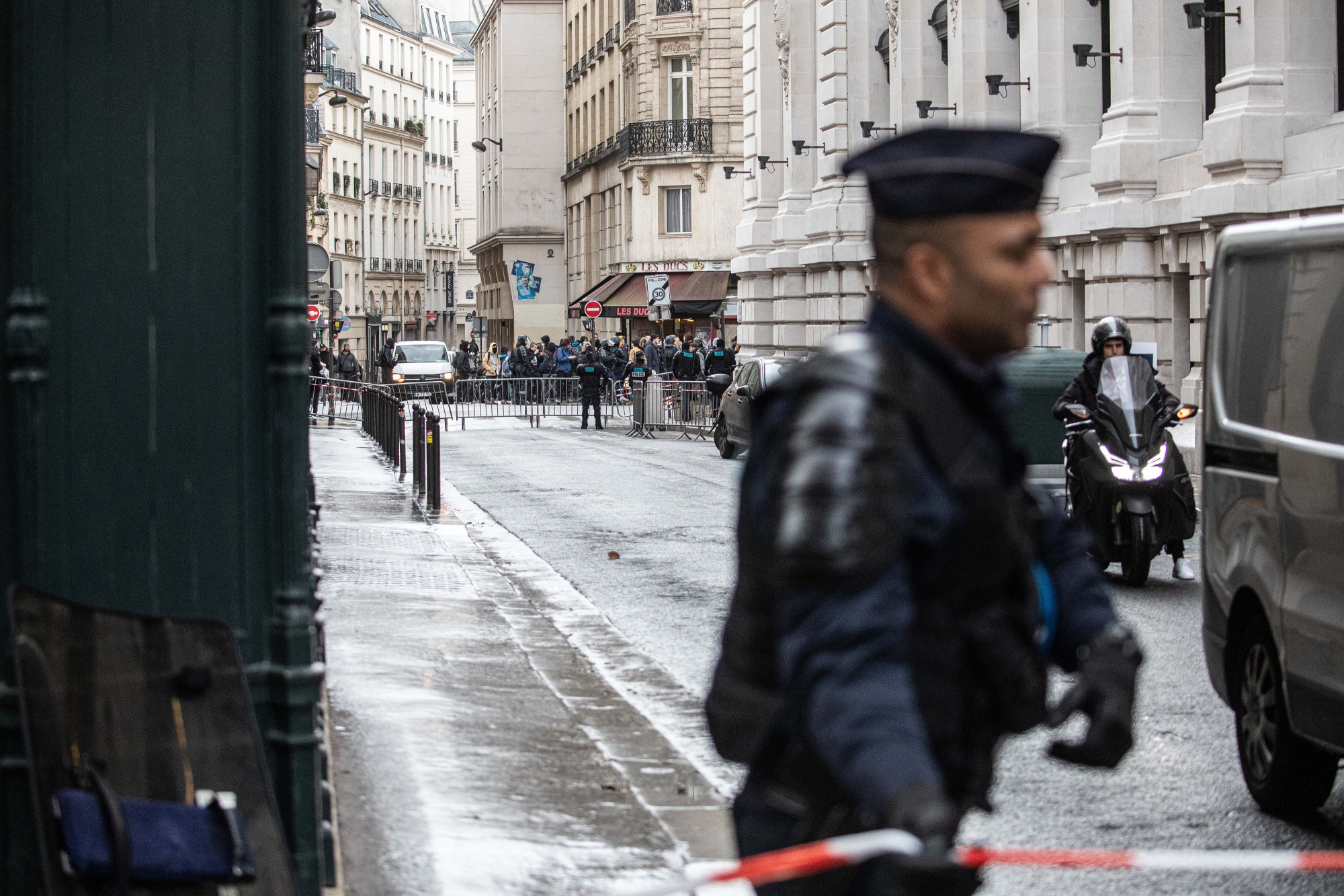 Police cordon off a road outside the Blackrock Inc. offices following a climate activist protest inside the building in Paris on Monday. BlackRock's Paris office was briefly barricaded by climate activists who sprayed red paint on the floors and covered the walls with graffiti before leaving the premises of the world's largest asset manager. | BLOOMBERG
