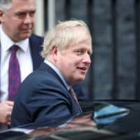 British Prime Minister Boris Johnson leaves Downing Street in London Feb. 11. | REUTERS