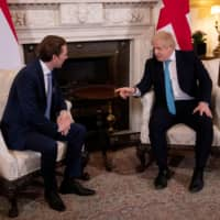 British Prime Minister Boris Johnson gestures as he meets with Austrian Chancellor Sebastian Kurz at Downing Street in London Tuesday. | REUTERS