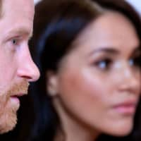 Britain's Prince Harry, Duke of Sussex, and Meghan, Duchess of Sussex, attend the annual WellChild Awards in London last fall. Prince Harry and his wife Meghan could be banned from using the 'Sussex Royal' label following their retreat from front-line duties, reports said on Wednesday. | TOBY MELVILLE / POOL / VIA AFP-JIJI