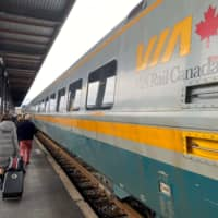 Travelers walk by a VIA train in Ottawa in December. Canadian Prime Minister Justin Trudeau warned Tuesday against the use of force to resolve a rail blockade sparked by indigenous protesters and now in its second week. | AFP-JIJI