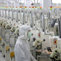 A production line at a microelectronics factory in Nantong, in eastern China's Jiangsu province | AP