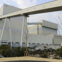 The newly completed No. 2 unit at Kyushu Electric Power Co.'s Matsuura coal-fired power plant in Nagasaki Prefecture is unveiled to the media Dec. 16. | KYODO