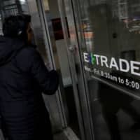 Morgan Stanley charts ambitious course with $13 billion E-Trade deal