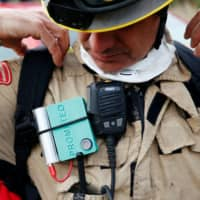 A Prometeo monitoring device, by IBM, is worn by a firefighter during a prescribed burn of the forest in Olivella, south of Barcelona, Spain, Feb. 11. | REUTERS