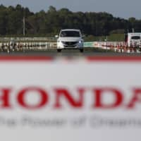 Honda Motor will take over vehicle development functions from its Honda R&D unit and absorb another unit involved in the development of machine tools. | REUTERS