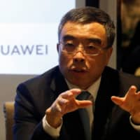 Huawei Technologies Chairman Liang Hua speaks during a news conference in Paris Thursday. | REUTERS