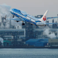 Japan Airlines Co. will cut back flights to South Korea's Busan and Gimpo airports, as well as those connecting Osaka and Taipei. | REUTERS