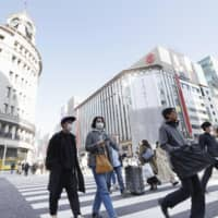 The Ginza shopping district of Tokyo on Feb. 21. Economists expect the new virus that causes COVID-19 to lower household consumption by more than ¥2 trillion ($18 billion). | KYODO