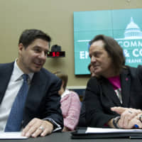 Sprint Corp. Executive Chairman Marcelo Claure (left) speaks with T-Mobile US CEO and President John Legere during the House Commerce subcommittee hearing on Capitol Hill in Washington last year. A federal judge has removed a major obstacle to T-Mobile's $26.5 billion takeover of Sprint, as he rejected claims by a group of states that the deal would mean less competition and higher phone bills. | AP