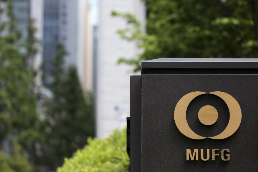 Mitsubishi UFJ Financial Group Inc. has posted its first quarterly loss in a decade and cut its annual profit forecast after booking a hefty charge on its stake in an Indonesian bank.   BLOOMBERG